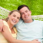 Man and Woman Cuddling in Hammock
